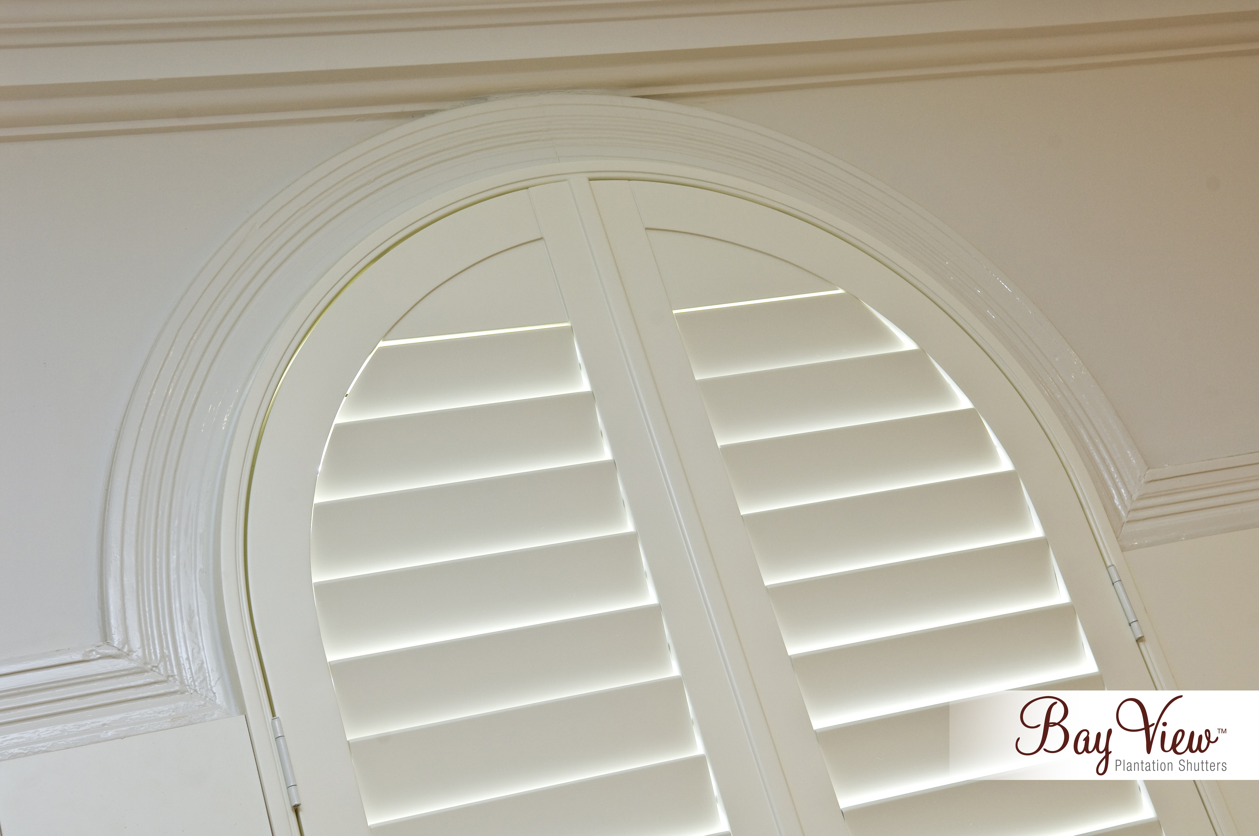 Basswood Shutters Arch